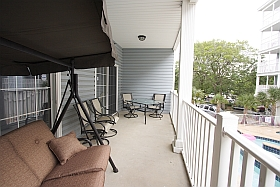 Lower Balcony with three person swing, table, four chairs