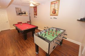 Game Room with Pool and Foosball Tables